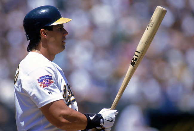 OAKLAND, CA - JUNE 14:  Jose Canseco #33 of the Oakland Athletics stands ready at the plate against the Colorado Rockies during a game at Oakland-Alameda County Coliseum on June 14, 1997 in Oakland, California.  The Rockies won 7-1.  (Photo by Otto Greule