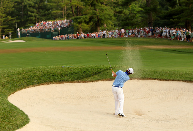 BETHESDA, MD - JUNE 19:  Rory McIlroy of Northern Ireland hits a bunker shot on the 16th hole during the final round of the 111th U.S. Open at Congressional Country Club on June 19, 2011 in Bethesda, Maryland.  (Photo by Andrew Redington/Getty Images)