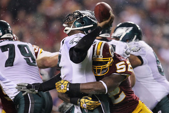 LANDOVER, MD - NOVEMBER 15:  Michael Vick #7 of the Philadelphia Eagles is sacked by Rocky McIntosh #52 of the Washington Redskins on November 15, 2010 at FedExField in Landover, Maryland.  (Photo by Chris McGrath/Getty Images)