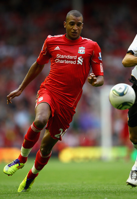 LIVERPOOL, ENGLAND - AUGUST 06:  David Ngog of Liverpool in action during the pre season friendly match between Liverpool and Valencia at Anfield on August 6, 2011 in Liverpool, England.  (Photo by Clive Brunskill/Getty Images)