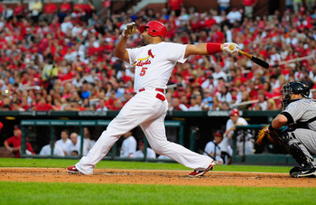 ST. LOUIS, MO - AUGUST 14: Albert Pujols #5 of the St. Louis Cardinals follows through on a two-run home run against the Colorado Rockies at Busch Stadium on August 14, 2011 in St. Louis, Missouri.  (Photo by Jeff Curry/Getty Images)