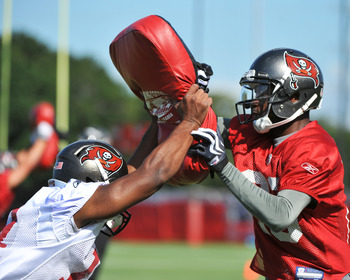 TAMPA, FL - JULY 29:  Wide receiver Detron Lewis #14 (L) of the Tampa Bay Buccaneers blocks against cornerback DJ Johnson #29 during the team's first pre-season training camp practice July 29, 2011 at One Buccaneer Place in Tampa, Florida. (Photo by Al Me