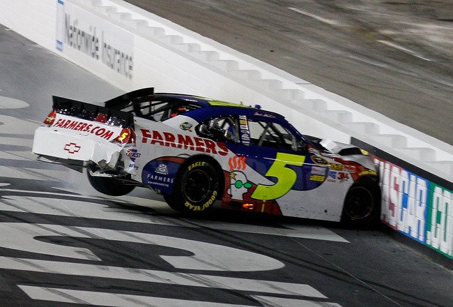 BRISTOL, TN - AUGUST 27:  Mark Martin, driver of the #5 Farmers Insurance/GoDaddy.com Chevrolet, hits the wall during the NASCAR Sprint Cup Series Irwin Tools Night Race at Bristol Motor Speedway on August 27, 2011 in Bristol, Tennessee.  (Photo by Chris