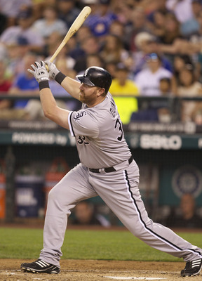 SEATTLE, WA - AUGUST 27:  Adam Dunn #32 of the Chicago White Sox takes a swing at the ball during a game against the Seattle Mariners at Safeco Field on August 27, 2011 in Seattle, Washington. (Photo by Stephen Brashear/Getty Images)
