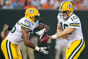 CLEVELAND, OH - AUGUST 13: Quarterback Matt Flynn #10 hands off to Ryan Grant #25 of the Green Bay Packers during the second quarter at Cleveland Browns Stadium on August 13, 2011 in Cleveland, Ohio. The Browns defeated the Packers 27-17. (Photo by Jason