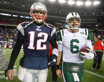 FOXBORO, MA - JANUARY 16:  Tom Brady #12 of the New England Patriots and Mark Sanchez #6 of the New York Jets walk off the field after the Jets defeated the Patriots 28 to 21 their 2011 AFC divisional playoff game at Gillette Stadium on January 16, 2011 i