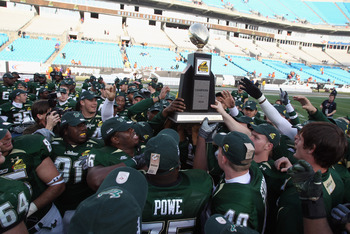 CHARLOTTE, NC - DECEMBER 31:  The USF Bulls celebrate with the trophy after a 31-26 victory over the Clemson Tigers at Bank of America Stadium on December 31, 2010 in Charlotte, North Carolina.  (Photo by Streeter Lecka/Getty Images)