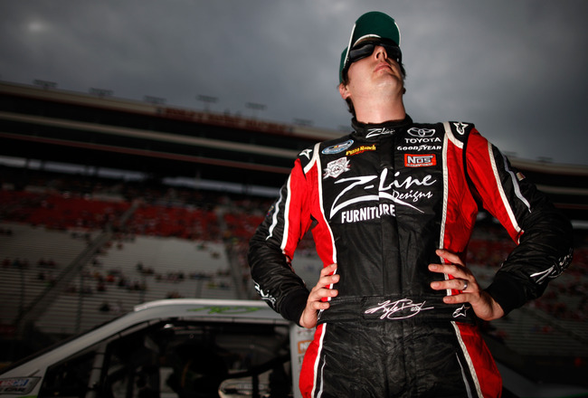 BRISTOL, TN - AUGUST 26:  Kyle Busch, driver of the #18 Wrigley's Doublemint Toyota, looks on during qualifying for the NASCAR Sprint Cup Series IRWIN Tools Night Race at Bristol Motor Speedway on August 26, 2011 in Bristol, Tennessee.  (Photo by Chris Gr