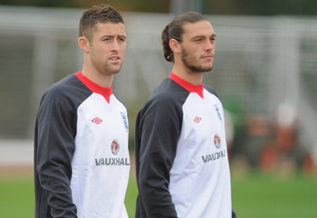 LONDON, ENGLAND - AUGUST 30: Andy Carroll and Gary Cahill look on during the England training session ahead of their UEFA EURO 2012 Group G qualifier against Bulgaria at London Colney on August 30, 2011 in London, England.  (Photo by Michael Regan/Getty I