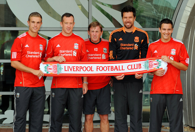 LIVERPOOL, UNITED KINGDOM - AUGUST 03:  Manager Kenny Dalglish (C) presents new signings (L-R) Jordan Henderson, Charlie Adam, Alexander Doni and Stewart Downing of Liverpool following a press conference at Melwood Training Ground on August 3, 2011 in Liv