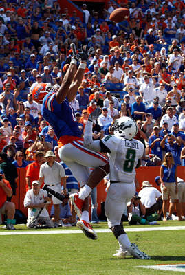 GAINESVILLE, FL - SEPTEMBER 11:  Jordan Reed #11 of the Florida Gators prepares to catch a pass for a touchdown against Jon Lejiste #8 of the South Florida Bulls during a game at Ben Hill Griffin Stadium on September 11, 2010 in Gainesville, Florida.  (Ph