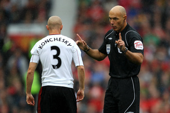 MANCHESTER, ENGLAND - SEPTEMBER 19:  Referee Howard Webb has words with Paul Konchesky of Liverpool during the Barclays Premier League match between Manchester United and Liverpool at Old Trafford on September 19, 2010 in Manchester, England.  (Photo by A