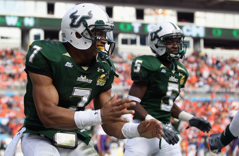CHARLOTTE, NC - DECEMBER 31:  B.J. Daniels #7 of the USF Bulls celebrates after scoring a touchdown against the Clemson Tigers during their game at Bank of America Stadium on December 31, 2010 in Charlotte, North Carolina.  (Photo by Streeter Lecka/Getty