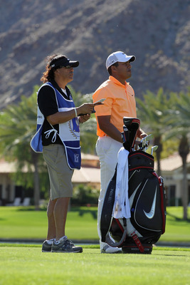 LA QUINTA, CA - JANUARY 23:  Jhonattan Vegas of Venezuela and his caddie discuss a shot during the final round of the Bob Hope Classic at the Palmer Private course at PGA West on January 23, 2011 in La Quinta, California.  (Photo by Jeff Gross/Getty Image