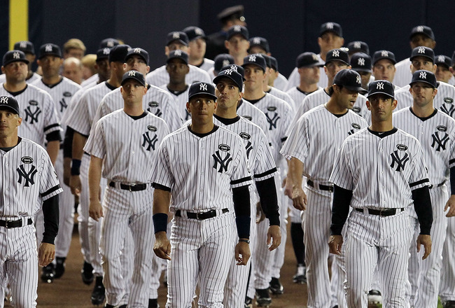 NEW YORK - SEPTEMBER 20:  Members of the New York Yankees attend the unveiling of late team owner George Steinbrenner's monument prior to playing against the Tampa Bay Rays on September 20, 2010 at Yankee Stadium in the Bronx borough of New York City.  (P
