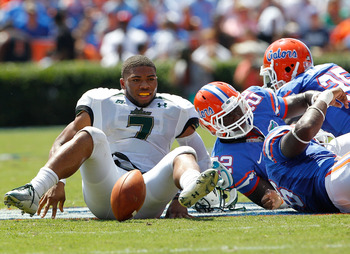 GAINESVILLE, FL - SEPTEMBER 11:  Quarterback B.J. Daniels #7 of the South Florida Bulls loses his helmet after being tackled during a game against the Florida Gators at Ben Hill Griffin Stadium on September 11, 2010 in Gainesville, Florida.  (Photo by Sam