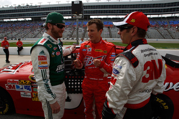 FORT WORTH, TX - APRIL 16:  (L-R) Dale Earnhardt Jr., driver of the #88 National Guard/AMP Energy Chevrolet, speaks to Kasey Kahne, driver of the #9 Budweiser Ford, and Greg Biffle, driver of the #16 3M Post-it Ford, after qualifying for the NASCAR Sprint