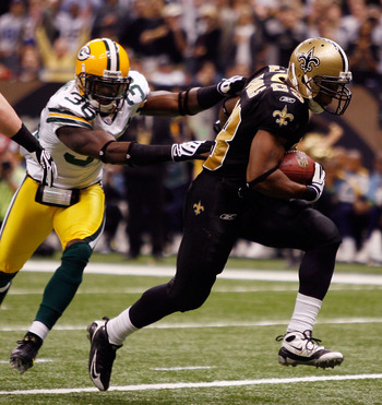 NEW ORLEANS - NOVEMBER 24:  Pierre Thomas #23 of the New Orleans Saints scores a touchdown in the first quarter around Nick Collins #36  of the Green Bay Packers on November 24, 2009 at the Superdome in New Orleans, Louisiana.  (Photo by Chris Graythen/Ge