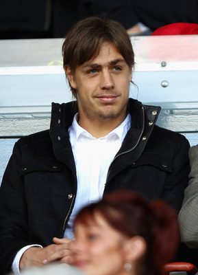 LIVERPOOL, ENGLAND - AUGUST 27:  New Liverpool signing Sebastian Coates looks on ahead of the the Barclays Premier League match between Liverpool and Bolton Wanderers at Anfield on August 27, 2011 in Liverpool, England.  (Photo by Clive Brunskill/Getty Im
