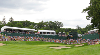 CROMWELL, CT - JUNE 26:  Fans fill the seats around the 18th green during the final round of the Travelers Championship at  TPC River Highlands on June 26, 2011 in Cromwell, Connecticut.  (Photo by Jim Rogash/Getty Images)