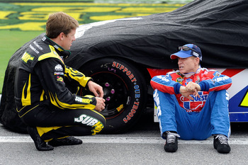 DAYTONA BEACH, FL - JULY 02:  Mark Martin, driver of the #5 CARQUEST Auto Parts/GoDaddy.com Chevrolet, speaks with Carl Edwards, driver of the #99 SUBWAY Ford, during qualifying for the NASCAR Sprint Cup Series Coke Zero 400 at Daytona International Speed
