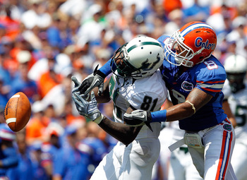 GAINESVILLE, FL - SEPTEMBER 11:  Jeremy Brown #8 of the Florida Gators breaks up a pass to Dontavia Bogan #81 of the South Florida Bulls during a game at Ben Hill Griffin Stadium on September 11, 2010 in Gainesville, Florida.  (Photo by Sam Greenwood/Gett