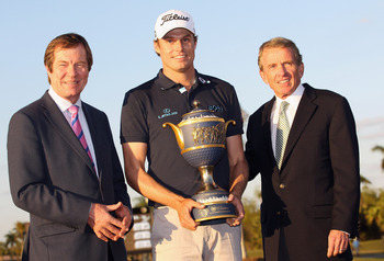 DORAL, FL - MARCH 13:  PGA Tour commissioner Tim Finchem (R) and George O'Grady, Chief Executive of The European Tour pose with Nick Watney after the final round of the 2011 WGC- Cadillac Championship at the TPC Blue Monster at the Doral Golf Resort and S