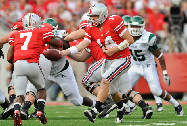 COLUMBUS, OH - SEPTEMBER 25:  Joe Bauserman #14 of the Ohio State Buckeyes hands off the ball to Jordan Hall #7 of the Ohio State Buckeyes against the Eastern Michigan Eagles at Ohio Stadium on September 25, 2010 in Columbus, Ohio.  Ohio State won 73-20.