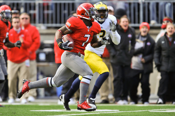 COLUMBUS, OH - NOVEMBER 27:  Jordan Hall #7 of the Ohio State Buckeyes returns a kickoff against the Michigan Wolverines at Ohio Stadium on November 27, 2010 in Columbus, Ohio.  (Photo by Jamie Sabau/Getty Images)