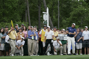 HUMBLE, TX - APRIL 03:  Phil Mickelson hits his drive on the 13th hole as Scott Verplank and the gallery look on during the final round of the Shell Houston Open at Redstone Golf Club on April 3, 2011 in Humble, Texas.  (Photo by Michael Cohen/Getty Image
