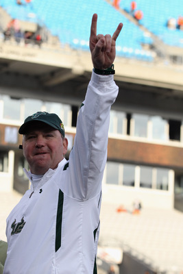 CHARLOTTE, NC - DECEMBER 31:  Head coach Skip Holtz of the USF Bulls celebrates after a 31-26 victory over the Clemson Tigers at Bank of America Stadium on December 31, 2010 in Charlotte, North Carolina.  (Photo by Streeter Lecka/Getty Images)