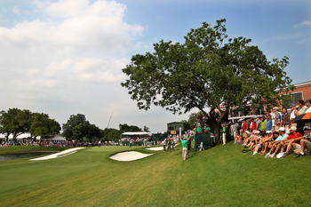 FORT WORTH, TX - MAY 22:  Fans watch play on the 18th green during the final round of the Crowne Plaza Invitational at Colonial Country Club on May 22, 2011 in Fort Worth, Texas. (Photo by Hunter Martin/Getty Images)