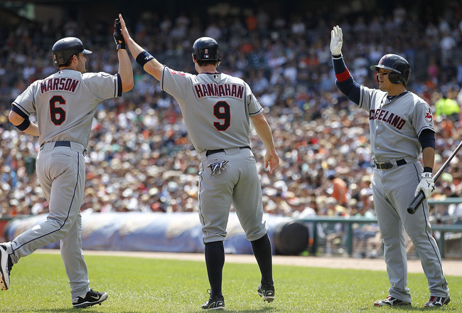 DETROIT - AUGUST 21: Lou Marson #6 and Jack Hannahan #9 of the Cleveland Indians celebrate with Shin-Soo Choo #17 after scoring on Michael Brantley #23 double to deep right field in the fourth inning during the game against the Detroit Tigers at Comerica