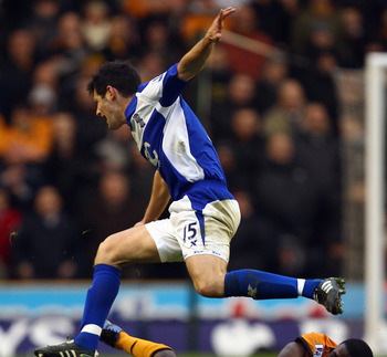 WOLVERHAMPTON, ENGLAND - DECEMBER 12:  Sylvan Ebanks-Blake of Wolves slides in on Scott Dann of Birmingham during the Barclays Premier League match between Wolverhampton Wanderers and Birmingham City at Molineux on December 12, 2010 in Wolverhampton, Engl
