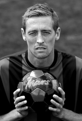 CAMBERWELL, ENGLAND - JUNE 7:   (EDITORS NOTE: THIS IMAGE HAS BEEN CONVERTED TO BLACK AND WHITE)  Peter Crouch poses for a photograph during the launch of the FA Mars Just Play campaign at Burgess Park Football Pitches on June 7, 2011 in Camberwell, Engla