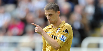 NEWCASTLE UPON TYNE, ENGLAND - AUGUST 28: Chris Baird of Fulham gestures during the Barclays Premier League match between Newcastle United and Fulham at St James' Park on August 28, 2011 in Newcastle upon Tyne, England.  (Photo by Chris Brunskill/Getty Im
