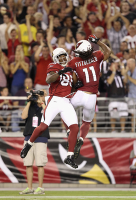 GLENDALE, AZ - AUGUST 27:  Wide receiver Larry Fitzgerald #11 of the Arizona Cardinals celebrates with Early Doucet #85 after scoring on a 80 yard touchdown reception against the San Diego Chargers during the first quarter of the preseason NFL game at the