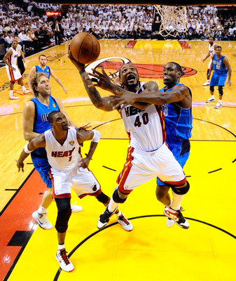 MIAMI, FL - JUNE 12:  Chris Bosh #1 of the Miami Heat attempts a shot against Ian Mahinmi #28 of the Dallas Mavericks in Game Six of the 2011 NBA Finals at American Airlines Arena on June 12, 2011 in Miami, Florida. NOTE TO USER: User expressly acknowledg