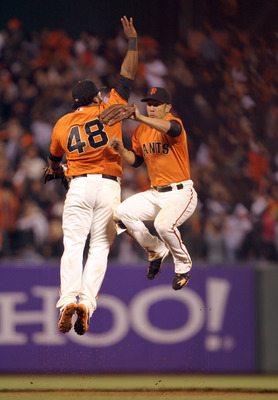 SAN FRANCISCO, CA - SEPTEMBER 02:  Pablo Sandoval #48 and Andres Torres #56 of the San Francisco Giants celebrate after they beat the Arizona Diamondbacks at AT&T Park on September 2, 2011 in San Francisco, California.  (Photo by Ezra Shaw/Getty Images)