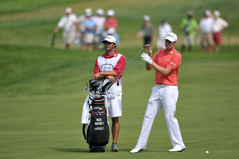 NEWTOWN SQUARE, PA - JULY 3: Nick Watney (R) pulls a club from his bag as his caddie looks on during the final round of the AT&T National at Aronimink Golf Club on July 3, 2011 in Newtown Square, Pennsylvania. (Photo by Drew Hallowell/Getty Images)