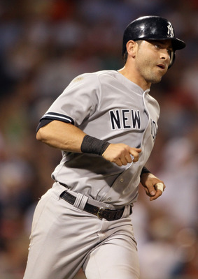 BOSTON, MA - AUGUST 30:  Francisco Cervelli #17 of the New York Yankees rounds the bases after he hit a solo home run in the fifth inning against the Boston Red Sox on August 30, 2011 at Fenway Park in Boston, Massachusetts.  (Photo by Elsa/Getty Images)