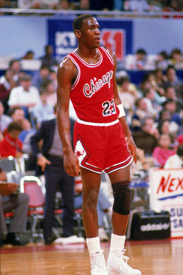 LOS ANGELES, CA - DECEMBER 1984:  Michael Jordan #23 of the Chicago Bulls stands on the court moves the ball at the parameter against the Los Angeles Clippers at the Sports Arena in Los Angeles, California.  (Photo by Rick Stewart/Getty Images)