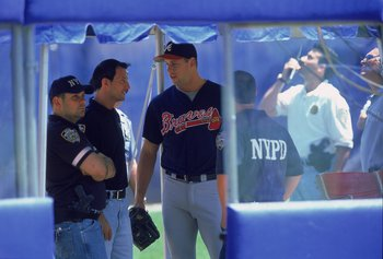 1 Jul 2000:  John Rocker #49 of Atlanta Braves talks to security under a protective tent before the game against the New York Mets at Shea Stadium in Flushing, New York. The Mets defeated the Braves 9-1.Mandatory Credit: Ezra O. Shaw  /Allsport