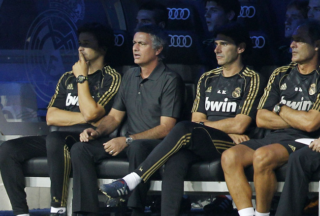MADRID, SPAIN - AUGUST 24:  Head coach Jose Mourinho (2nd L) of Real Madrid watches the game from the bench during the Santiago Bernabeu Trophy match between Real Madrid and Galatasaray at Estadio Santiago Bernabeu on August 24, 2011 in Madrid, Spain.  (P