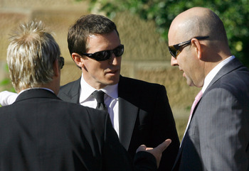 SYDNEY, AUSTRALIA - JUNE 25: Television personality Rove McManus (C) chats with former Australian cricketers Shane Warne (L) and Darren Lehmann (R) following the memorial service for Jane McGrath, the wife of former Australian cricketer Glenn McGrath, at