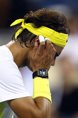 NEW YORK, NY - AUGUST 30:  Rafael Nadal of Spain looks on against Andrey Golubev of Kazakhstan during Day Two of the 2011 US Open at the USTA Billie Jean King National Tennis Center on August 30, 2011 in the Flushing neighborhood of the Queens borough of
