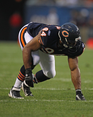 CHICAGO, IL - AUGUST 13:  Vernon Gholston #94 of the Chicago Bears awaits the snap against the Buffalo Bills during a preseason game at Soldier Field on August 13, 2011 in Chicago, Illinois.The Bears defeated the Bills 10-3.  (Photo by Jonathan Daniel/Get