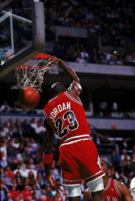 1990:  Michael Jordan #23 of the Chicago Bulls dunks the ball during the game.   Mandatory Credit