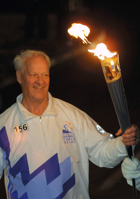 6 Jan 2002:  Torchbearer Gordie Howe carries the Olympic Flame during the 2002 Salt Lake Olympic Torch Relay in  Warren, Michigan. DIGITAL IMAGE.  Mandatory Credit: Todd Warshaw/Pool/Getty Images
