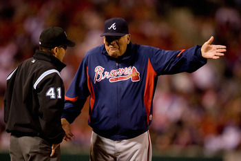 ST. LOUIS - APRIL 27: Manager Bobby Cox #6 of the Atlanta Braves argues a call with third base umpire Jerry Meals #41 against the St. Louis Cardinals at Busch Stadium on April 27, 2010 in St. Louis, Missouri.  (Photo by Dilip Vishwanat/Getty Images)